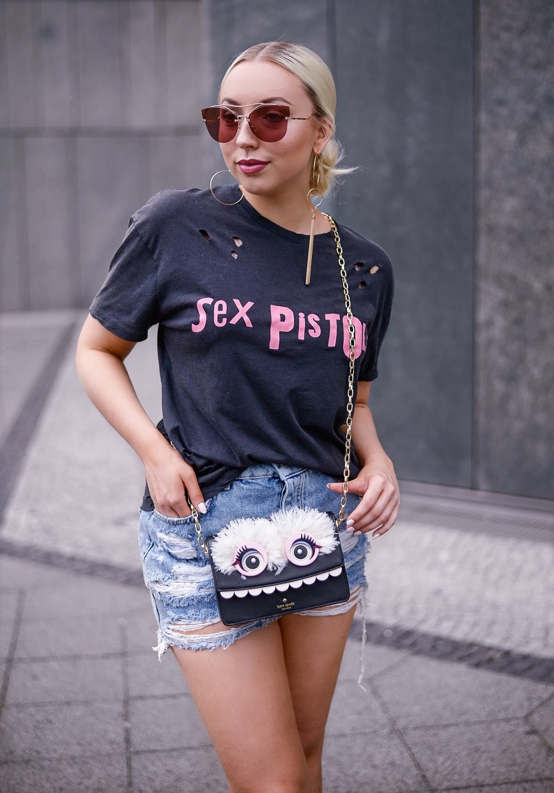 sex pistols_bandshirt_ripped denim shorts_kate spade bag