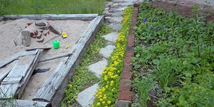 kierrätys puutarhassa tiilet hirret