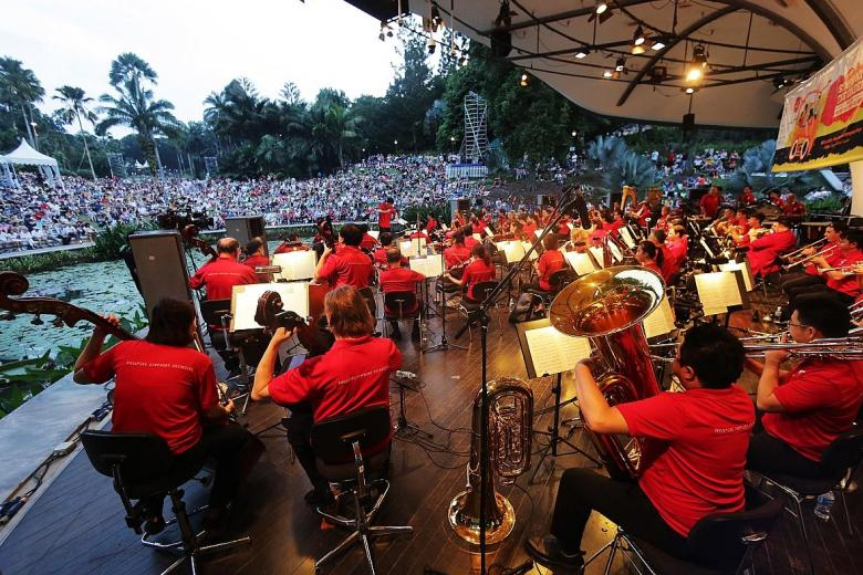 Attendees listening to the Singapore Symphony Orchestra yesterday evening at the Singapore Botanic Gardens.