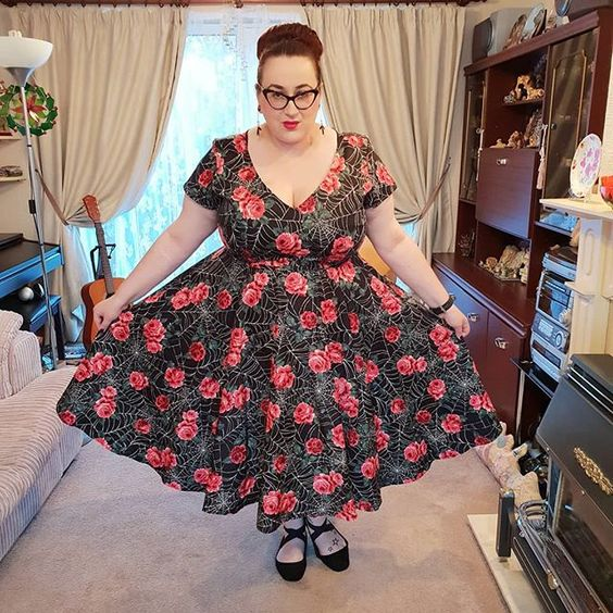 plus size girl wearing Vixen by Micheline Pitt Vanity Fair dress in Spider Web