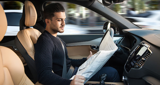 Autonomous car user, reading