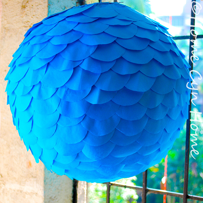 This gorgeous paper fish scale lamp started as an old faded ugly paper lantern that spent too much time in the sun.
