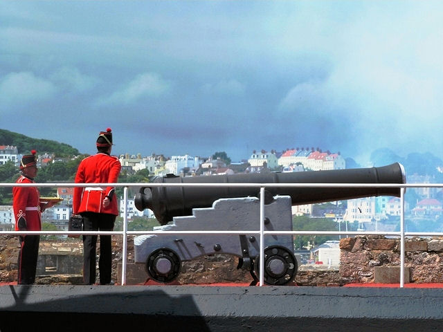 The Midday Gun fires NOON time at the Castle Cornet in Saint Peter Port, Guernsey. Photo: Zoë Dawes. Unauthorized use is prohibited.