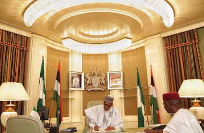 photos of pres buhari in his office as he resumes work