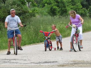 family bicycling the Pere Marquette Trail