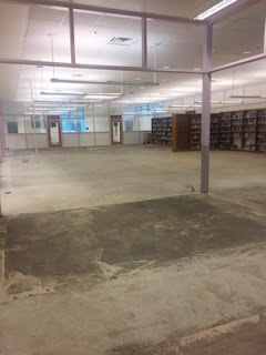 Concrete floors and support poles in large open area