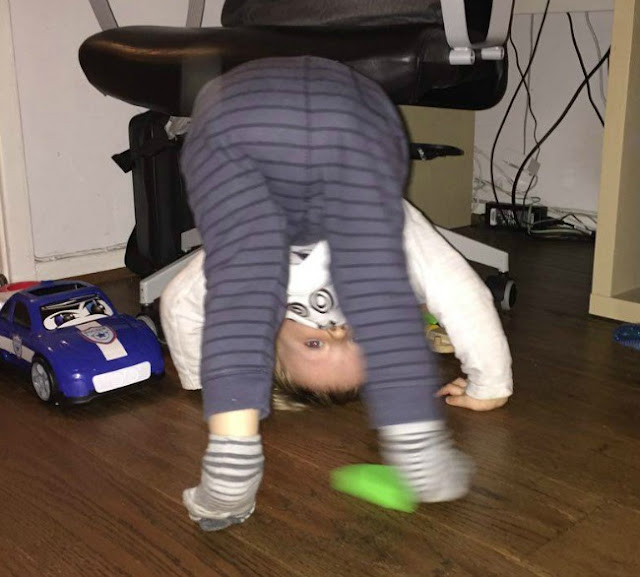 toddler trying to do a head stand