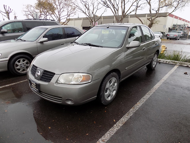 2004 Nissan Sentra with full car paint job from Almost Everything Auto Body.