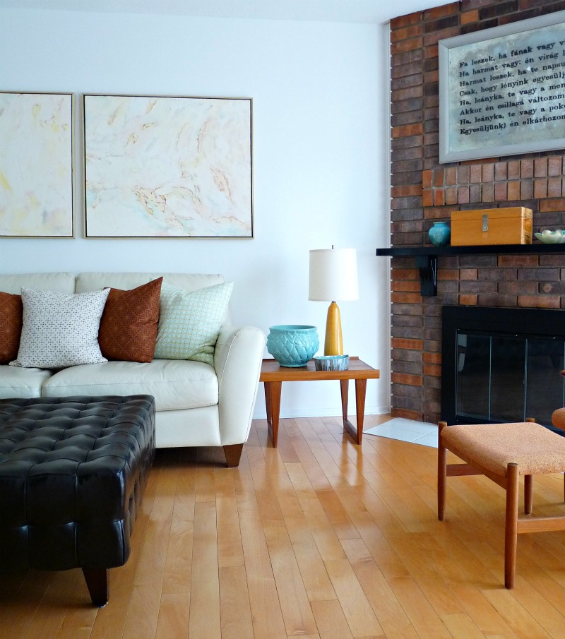 Brick fireplace with unusual mirror