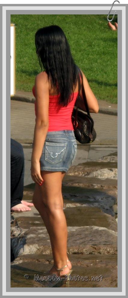Sexy Tanned Girl in Jean Mini Skirt
