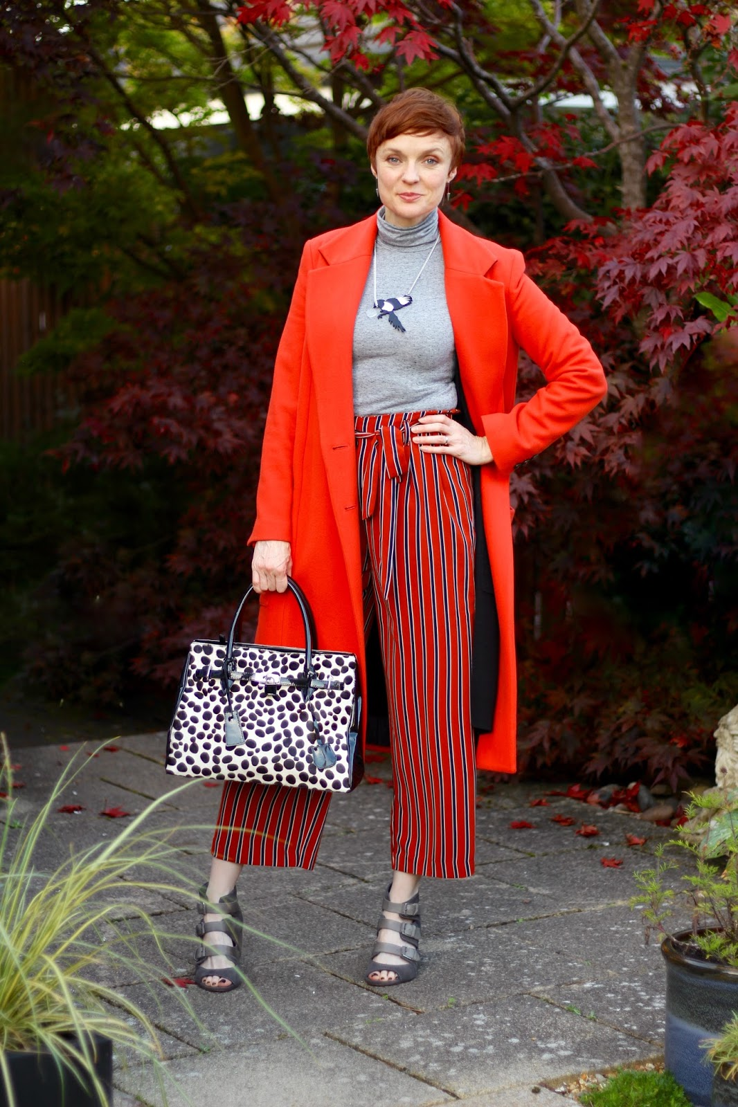 Orange wool coat, striped culottes, roll neck & grey sandals... Autumn outfit, over 40.