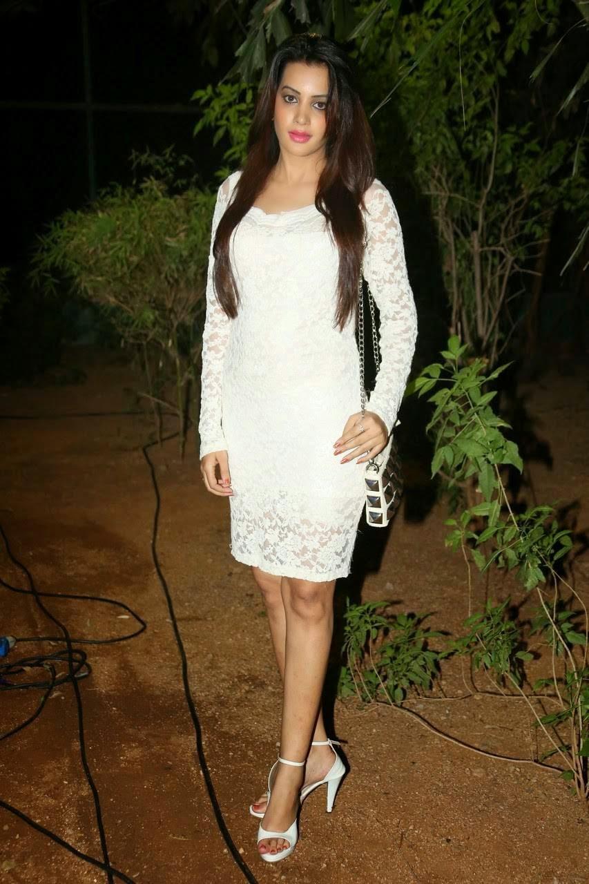 Actress Diksha Panth Latest Photo Gallery, Actress Diksha Panth Crossleg Sitting Pics in White Dress from Event