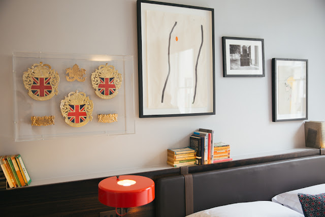 Guest room with art gallery wall at The Laslett Hotel in Notting Hill in the heart of West London