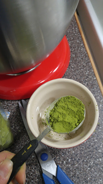 A tablespoon of green matcha tea powder.