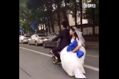 This Video's Actually Funny But Don't Laugh… Bride Falls Off Her Husband's Motorcycle on Their Wedding Day