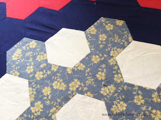 Laura Ashley fabrics in traditional hexagon quilt
