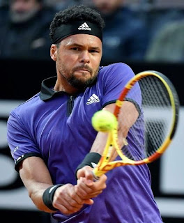 Tsonga rallies to reach quarterfinals in Lyon