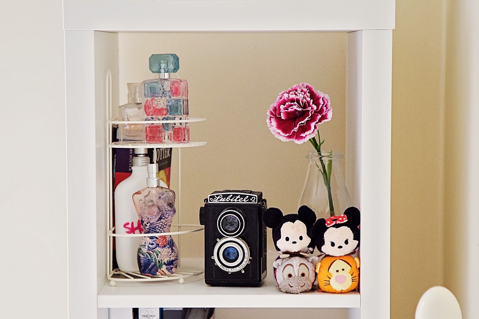 Disney Tsum Tsums displayed on a shelf.