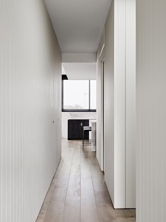 Hallway, shiplap walls | Hampton Penthouse. Interior design by Huntly, photo by Brooke Holm