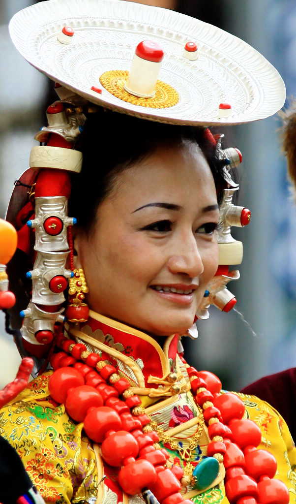 Woman from Kham region wearing traditional headdress and jewelry