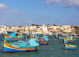 Traditional Maltese fishing boats. Photograph by Janie Robinson, Travel Writer