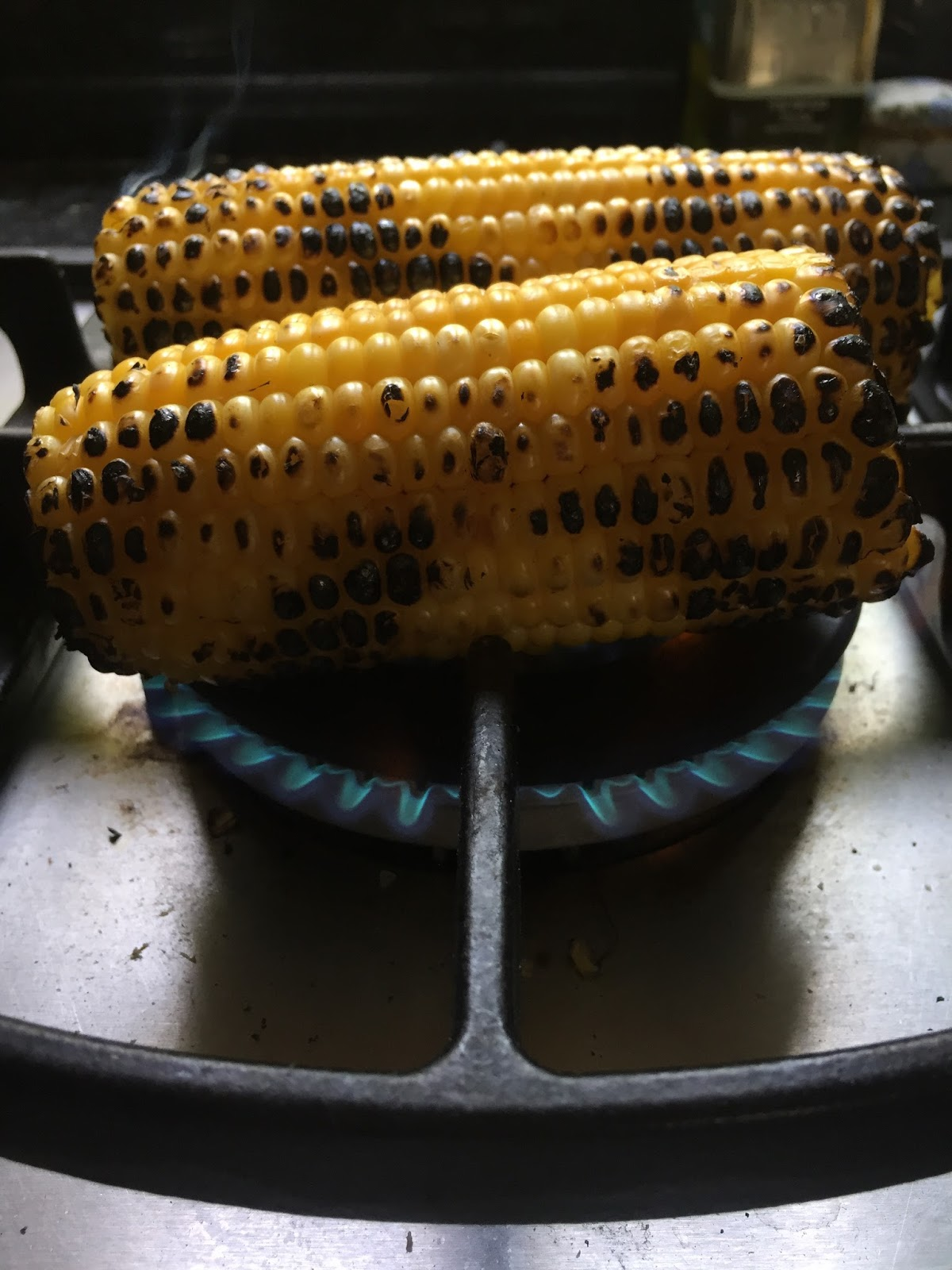 The katamon kitchen fire roasted corn salad allow the corn to cool and place the peppers in a bowl and cover with plastic wrap to steam this will allow them to steam so that you can peel the peppers ccuart Image collections