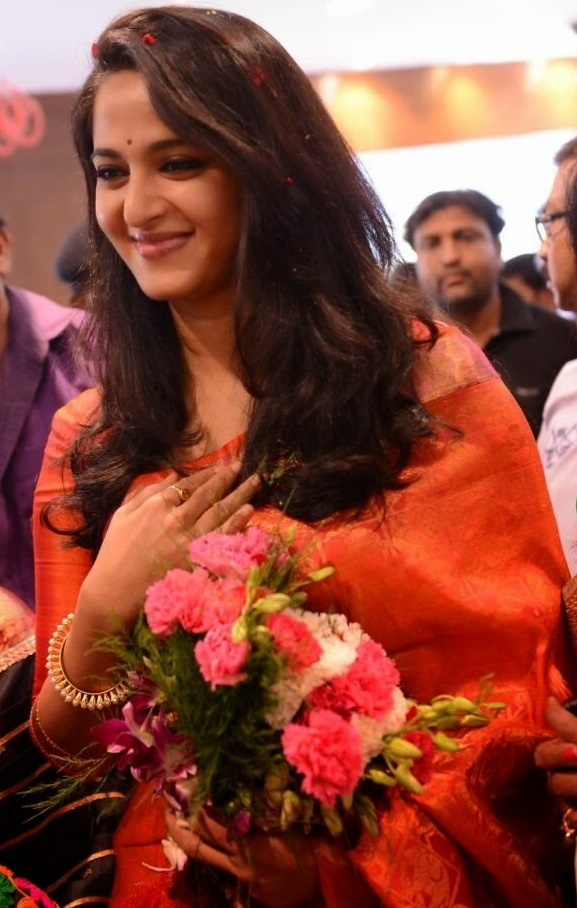 Anushka Shetty Photos In Orange Saree