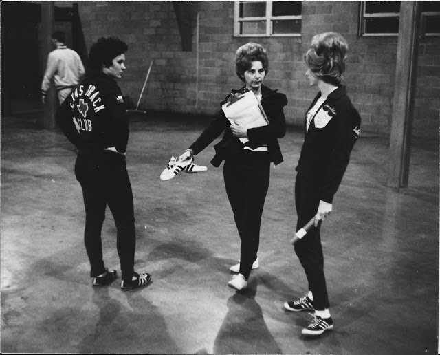 _ Flamin' Mamie's Bouffant Belles Margaret-Ellison talking with two members of the track team