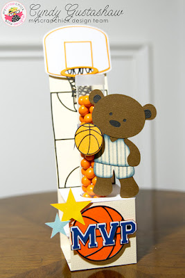 Treat holder for test tubes decorated as a basketball court