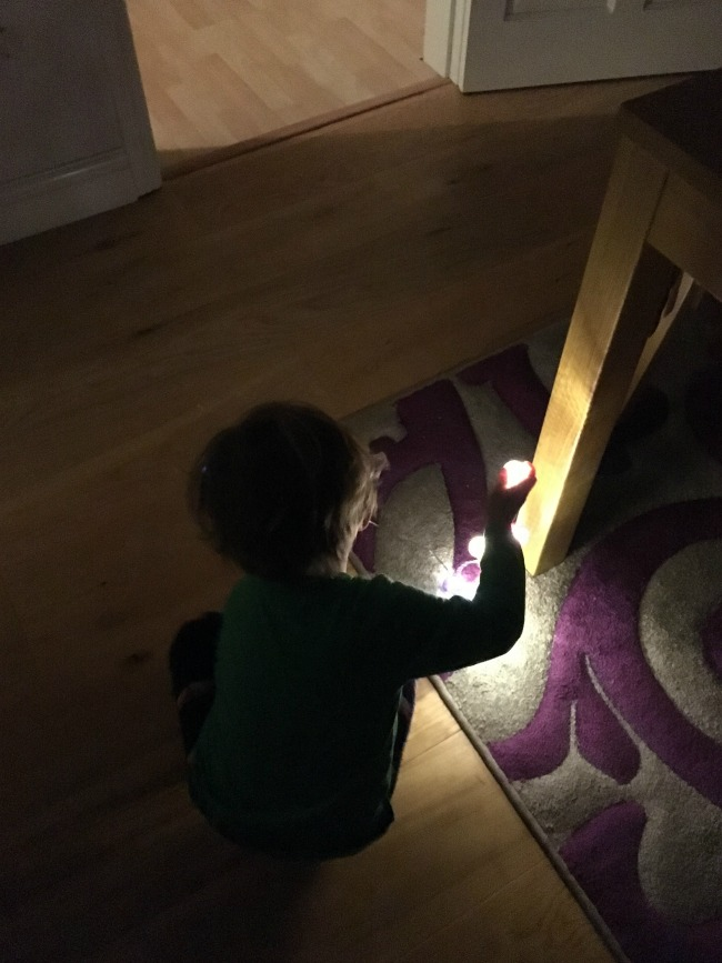 10-five-minute-games-for-toddlers-image-of-toddler-playing-hide-and-seek-with-lights