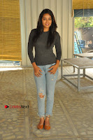 Actress Bhanu Tripathri Pos in Ripped Jeans at Iddari Madhya 18 Movie Pressmeet  0043.JPG