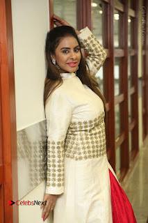 Telugu Actress Sri Reddy Mallidi Stills in White Beautiful Dress at Marriage Needs Bridal Fashion Week 2017 Logo Launch  0015.JPG