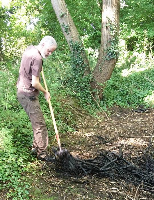 Roger Proudfoot raking Debdale pond