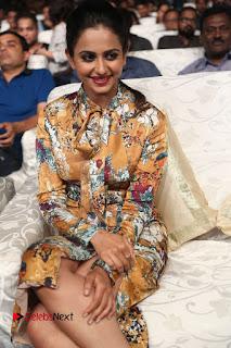 Actress Rakul Preet Singh Stills in Short Dress at Dhruva Pre Release Function  0036.JPG