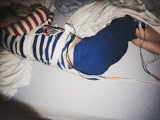 Boy asleep with wires along his body