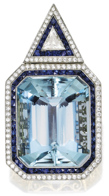 A contemporary aquamarine, diamond, and sapphire pendant.
