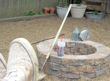 Finished fire pit with sneakers