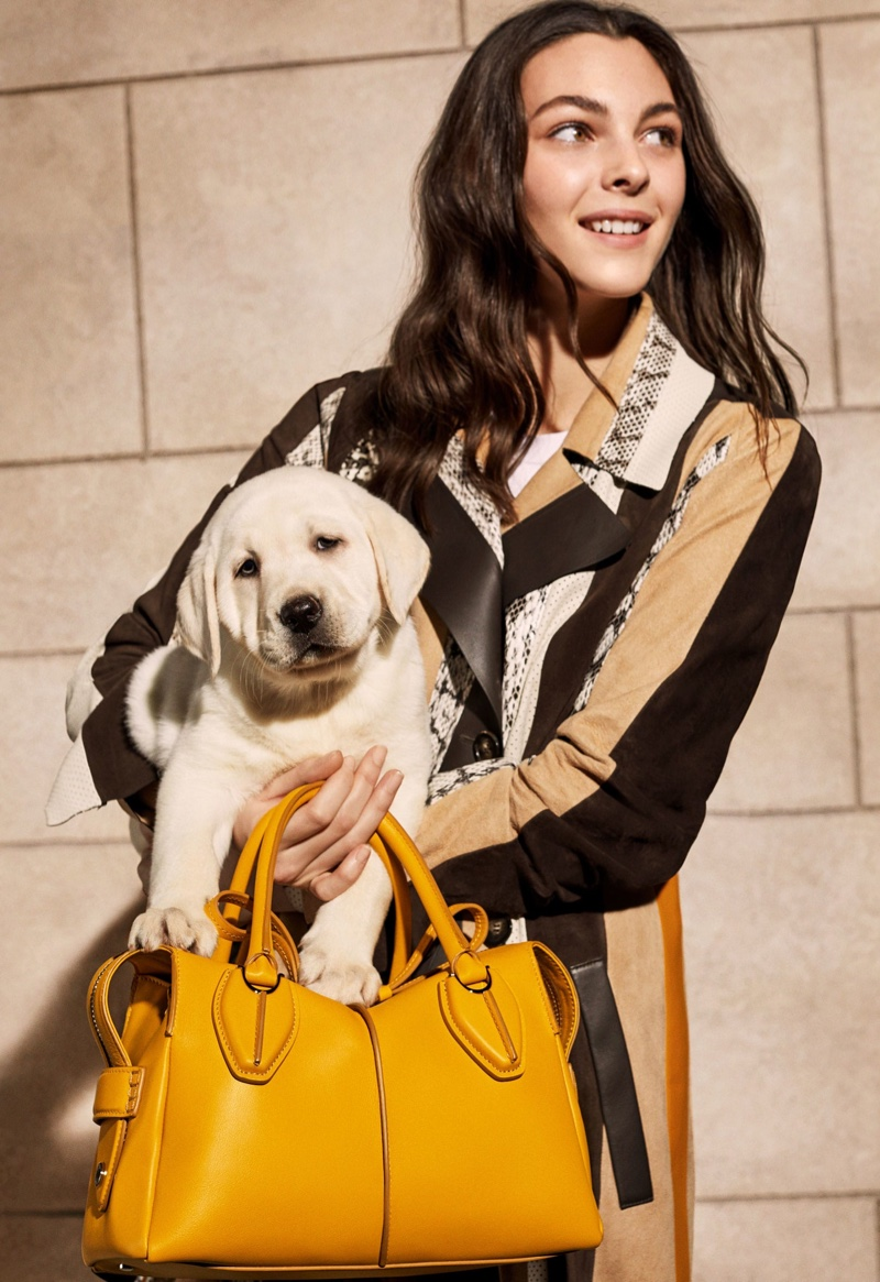 Vittoria Ceretti poses with a dog on set of Tod's spring 2019 shoot