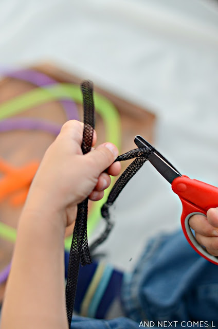 Practice fine motor scissor skills with Halloween colored tubing from the dollar store from And Next Comes L