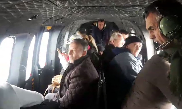 The persons inside the helicopter while being evacuated