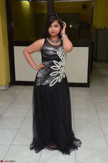 Shrisha Dasari in Sleeveless Short Black Dress At Follow Follow U Audio Launch 083.JPG