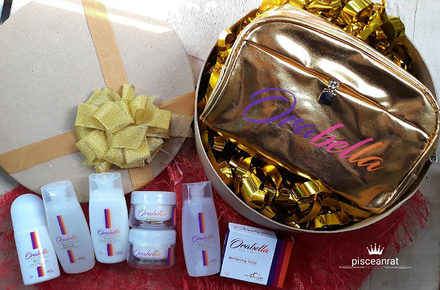 orabella golden pouch containing the products- Whitening 5-in-1 Deodorant, Whitening Intimate Wash, Whitening Hand & Body Lotion, Whitening 8-in-1 Day Cream, Whitening 2-in-1 Night Cream, Whitening Facial Toner and Whitening Soap.