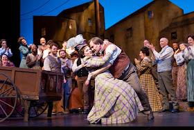 IN REVIEW: soprano MELINDA WHITTINGTON as Nedda (center left) and tenor CARL TANNER as Canio (center right) in North Carolina Opera's January 2020 production of Ruggero Leoncavallo's PAGLIACCI [Photograph by Eric Waters, © by North Carolina Opera]