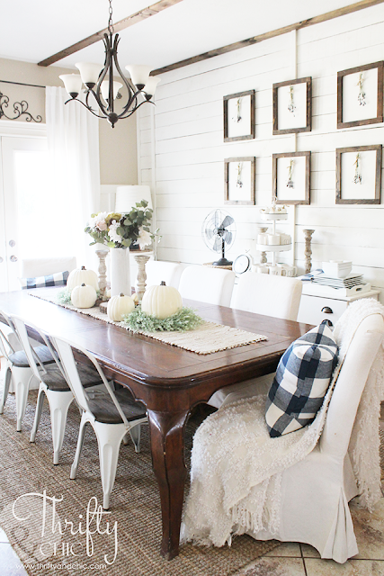 Farmhouse fall decor and decorating ideas. Pastel fall decor. How to decorate for fall. Neutral fall decorating ideas. Fall dining room decor and decorating ideas. Farmhouse fall dining room. White and brown dining room. Buffalo check pillows