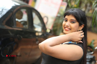 Actress Model Poorni Stills in Floral Long Dress at Silk India Expo Launch  0036.JPG