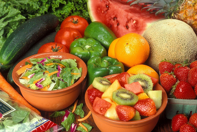 Bowl of Lettuce Salad and Fruit Salad