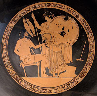 Hephaestus hands in the new Achilles' armor to Thetis.