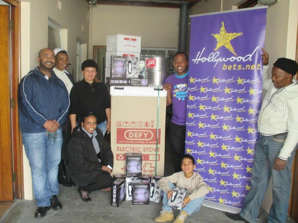 Hollywoodbets Parow team with donations made to the Holy Cross Care Centre - CSI - Social Responsibility