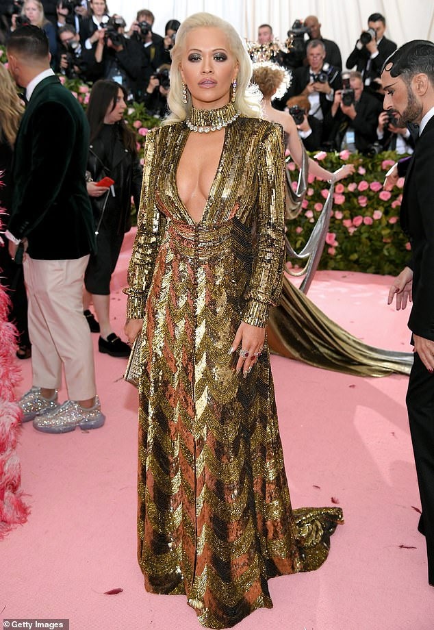 2019 Met Gala: Rita Ora flaunts cleavage in plunging black and gold patterned gown
