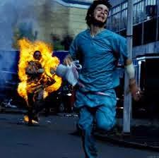 Cillian Murphy running from rage zombie on fire after waking up to find world gone